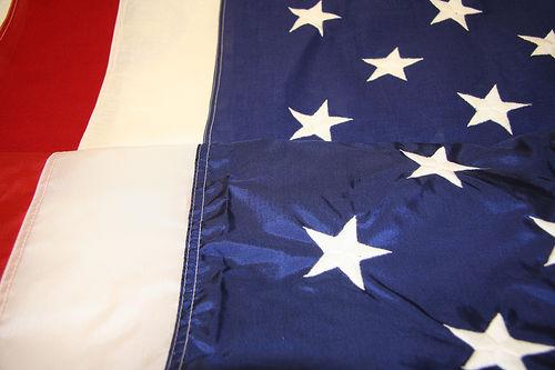 Cotton flag above, nylon flag below.